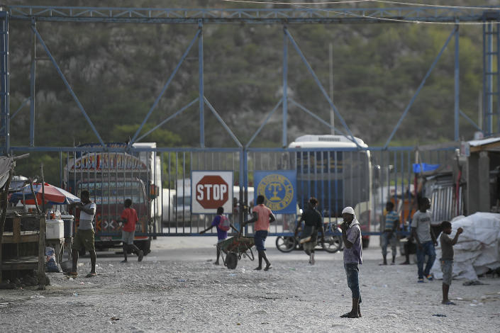 The entrance gate to Haiti is closed seen from Jimani, Dominican Republic, Thursday, July 8, 2021. Dominican President Luís Abinader ordered the closure of the border on Wednesday, after Haiti's government reported that a team of gunmen had assassinated President Jovenel Moïse. (AP Photo/Matias Delacroix)