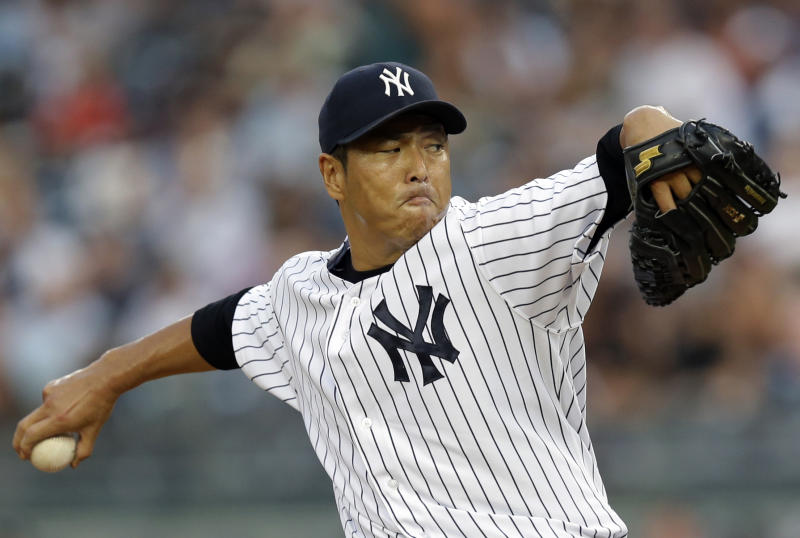 New York Yankees starting pitcher Hiroki Kuroda delivers in the first inning of a baseball game against the Los Angeles Angels, Monday, Aug. 12, 2013, in New York. (AP Photo/Kathy Willens)