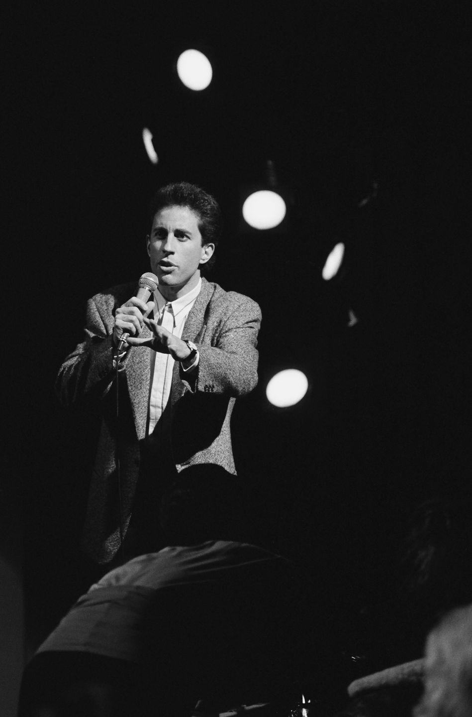 <p>Jerry Seinfeld began his career in comedy clubs and first debuted his stand-up act in 1976. He grew in prominence in the early '80s thanks to gigs on <em>The Tonight Show.</em></p>