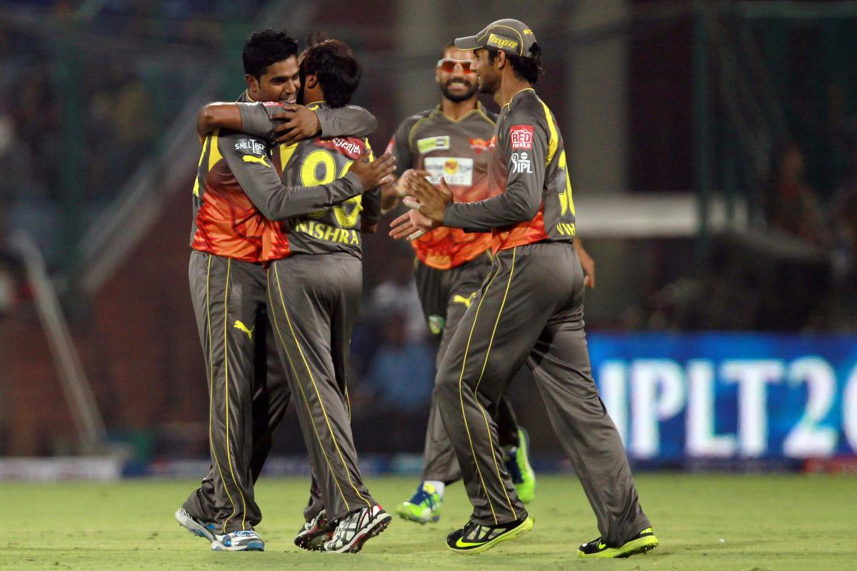 Amit Mishra is congratulated by his teammates on taking the wicket of Ajinkya Rahane during the Eliminator match of the 2013 Pepsi Indian Premier League between the Rajasthan Royals and the Sunrisers Hyderabad held at the Feroz Shah Kotla Stadium, Delhi on the 22nd May 2013. (BCCI)