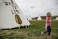 A group protesting the Dakota Access oil pipeline has set up teepees on the National Mall near the Washington Monument in Washington, Tuesday, March 7, 2017. A federal judge declined to temporarily stop construction of the final section of the disputed Dakota Access oil pipeline, clearing the way for oil to flow as soon as next week. (AP Photo/Andrew Harnik)