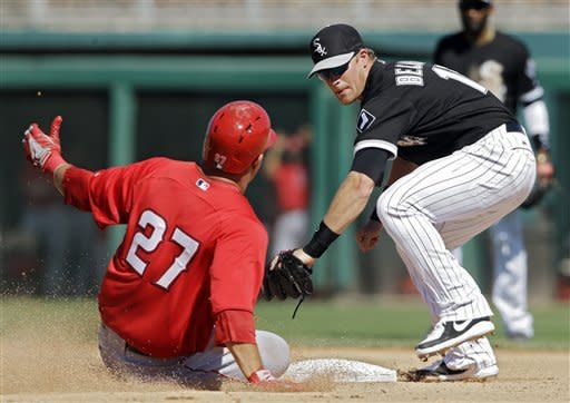 Chicago White Sox second baseman Gordon Beckham, right, puts out Los Angeles Angels' Mike Trout (27) tagging from first on a fly out by Erick Aybar in the sixth inning of an exhibition spring training baseball game, Monday, March 25, 2013, in Glendale, Ariz. (AP Photo/Mark Duncan)