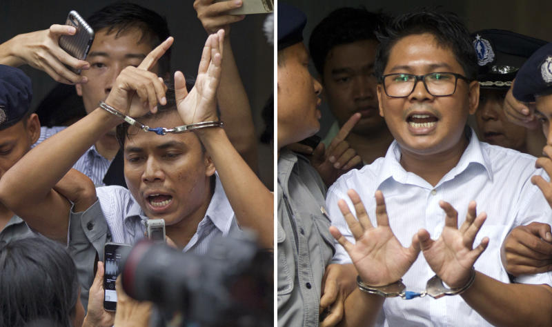 FILE - In this Sept. 3, 2018, combination file photo, Reuters journalists Kyaw Soe Oo, left, and Wa Lone, are handcuffed as they are escorted by police out of a court in Yangon, Myanmar. Myanmar's Supreme Court on Tuesday, April 23, 2019, rejected the final appeal of the two Reuters journalists and upheld seven-year prison sentences for their reporting on the military's brutal crackdown on Rohingya Muslims. They earlier this month shared with their colleagues the Pulitzer Prize for international reporting, one of journalism's highest honors. (AP Photo/Thein Zaw, File)