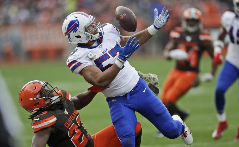 FILE - In this Nov. 10, 2019, file photo Buffalo Bills outside linebacker Lorenzo Alexander (57) breaks up a pass intended for Cleveland Browns running back Kareem Hunt (27) during the second half of an NFL football game in Cleveland. Vowing to retire after this season, the 13-year NFL veteran knows Sunday's regular-season finale against the New York Jets won't be his final game for the playoff-bound Bills. (AP Photo/Ron Schwane, File)