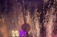 Fireworks explode past the Times Square Ball after it dropped to signal the start of the new year in Times Square, Midtown, New York January 1, 2014. REUTERS/Adrees Latif