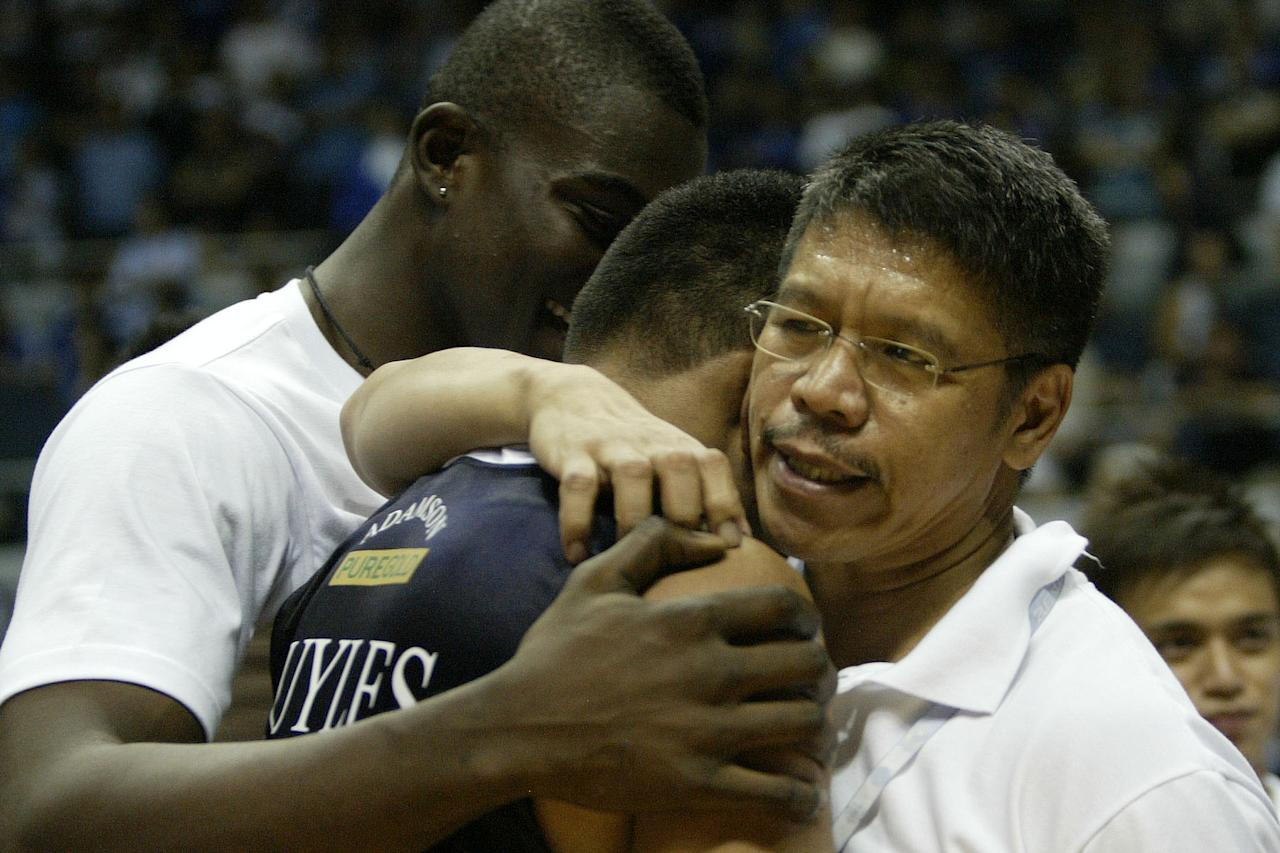 Coach Leo Austria of Adamson Soaring Falcons hugs Alex Nuyles after the match against Ateneo Blue Eagles during the UAAP Season 74 basketball game held at Smart Araneta Coliseum, Quezon City. (Marlo Cueto/NPPA Images)