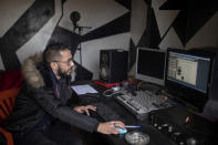 In this Thursday, Nov. 21, 2019 photo, Moroccan rapper Yahya Semlali, 31, known as LZ3er, works in his studio in Fes, Morocco. (AP Photo/Mosa'ab Elshamy)