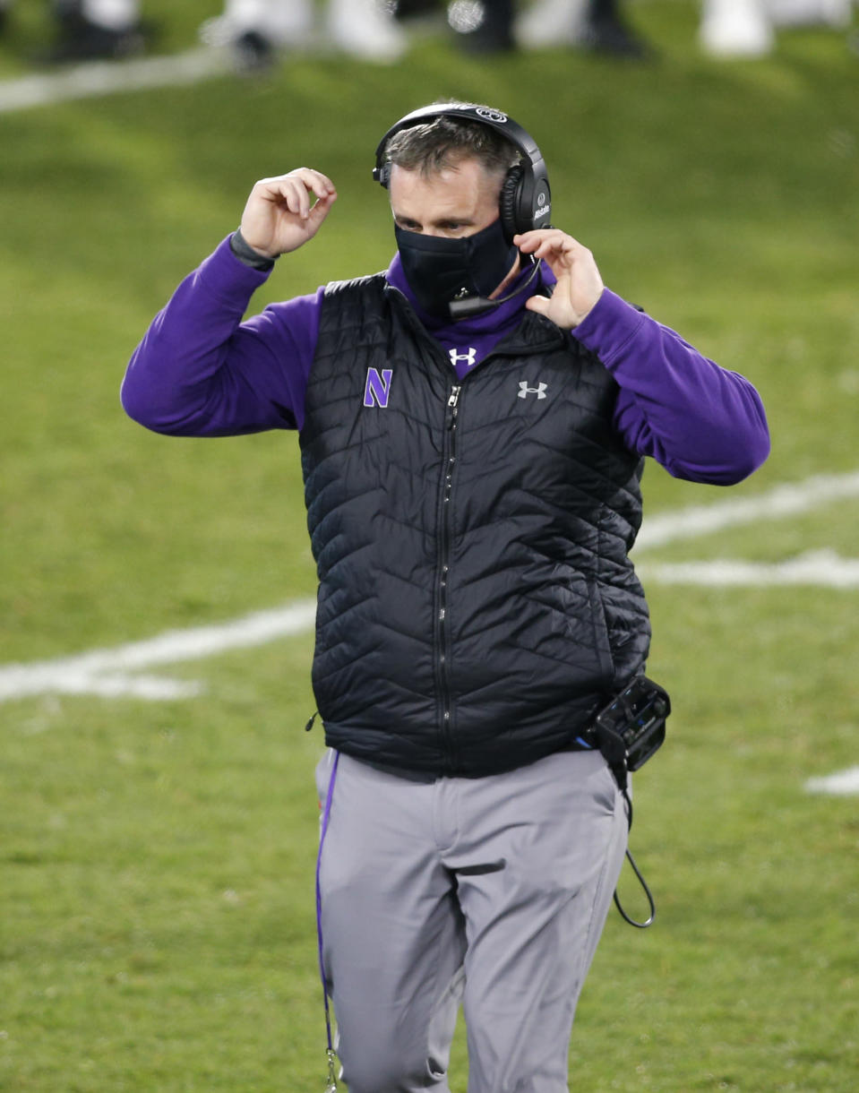 Northwestern coach Pat Fitzgerald walks on the field during the fourth quarter of the team's NCAA college football game against Michigan State, Saturday, Nov. 28, 2020, in East Lansing, Mich. Michigan State won 29-20. (AP Photo/Al Goldis)