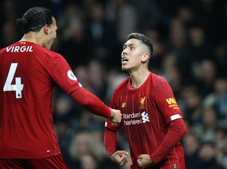 Roberto Firmino (right) and Liverpool have now earned more points after 21 games than any team in the history of Europe's top five leagues. (Photo by Mark Leech/Offside/Offside via Getty Images)