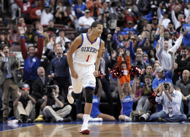 Philadelphia 76ers' Michael Carter-Williams (1) celebrates after making a 3-point basket during the first half of an NBA basketball game against the Miami Heat, Wednesday, Oct. 30, 2013, in Philadelphia. The 76ers won 114-110. (AP Photo/Michael Perez)