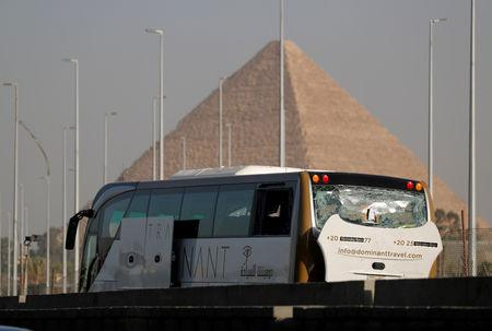 FILE PHOTO: A damaged bus is seen at the site of a blast near a new museum being built close to the Giza pyramids in Cairo, Egypt, May 19, 2019. REUTERS/Amr Abdallah Dalsh/File Photo