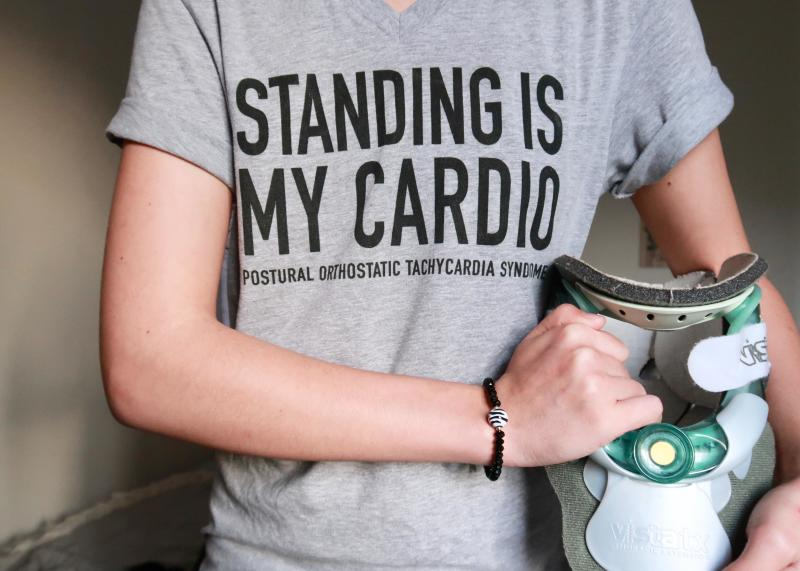 """Jennifer wearing a t-shirt that says """"standing is my cardio."""""""