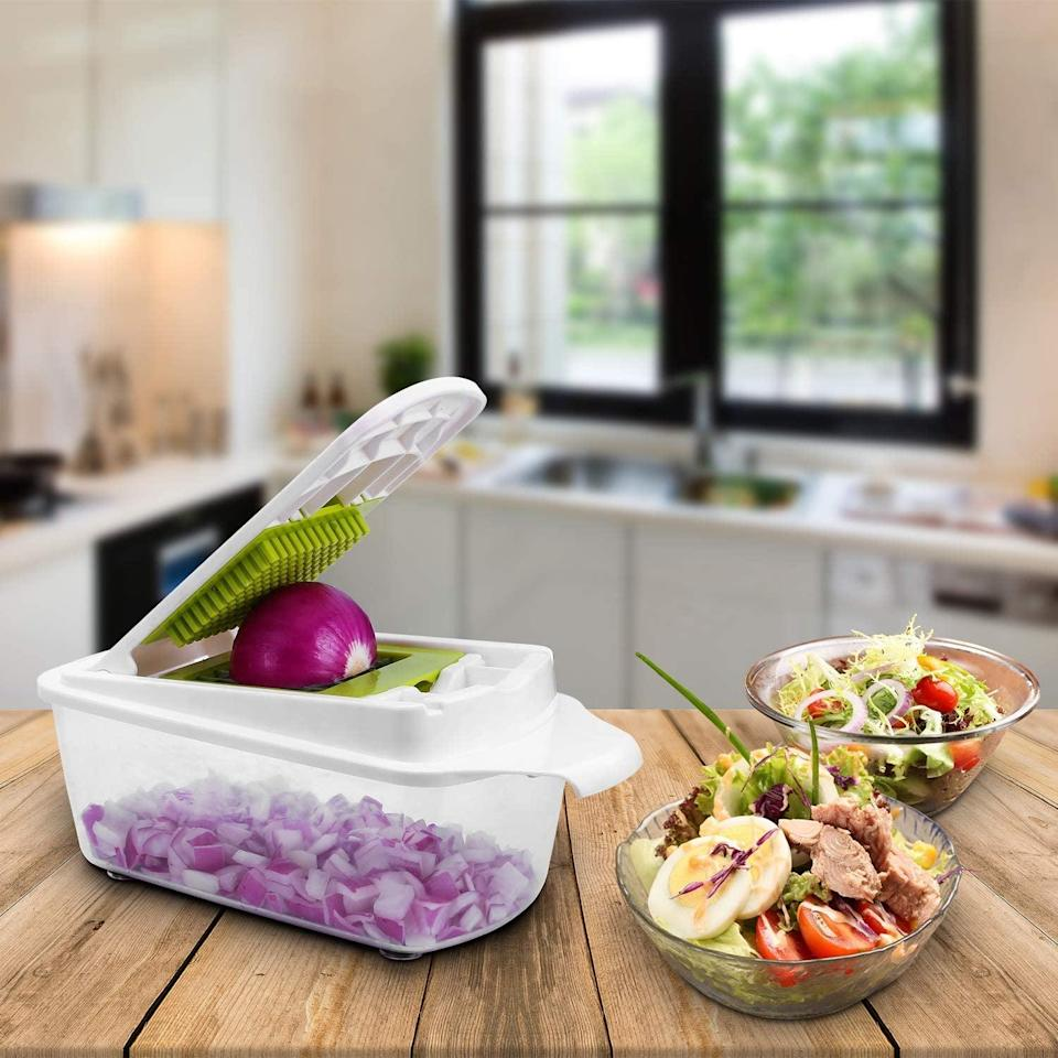 """<p>Dice up veggies for your salads, soups, and sides super easily with this tool. It minces, slices, grates, and chops, all for less than $35. </p> <p><a href=""""https://www.popsugar.com/buy/Sedhoom-23--1-Food-Chopper-Mandoline-Slicer-579727?p_name=Sedhoom%2023-in-1%20Food%20Chopper%20and%20Mandoline%20Slicer&retailer=amazon.com&pid=579727&price=34&evar1=fit%3Auk&evar9=44742696&evar98=https%3A%2F%2Fwww.popsugar.com%2Ffitness%2Fphoto-gallery%2F44742696%2Fimage%2F44743253%2FFast-Slicing-Dicing&list1=healthy%20living%2Chealthy%20cooking%20tips%2Cmeal%20prep&prop13=api&pdata=1"""" class=""""link rapid-noclick-resp"""" rel=""""nofollow noopener"""" target=""""_blank"""" data-ylk=""""slk:Sedhoom 23-in-1 Food Chopper and Mandoline Slicer"""">Sedhoom 23-in-1 Food Chopper and Mandoline Slicer</a> ($34, originally $37)</p>"""