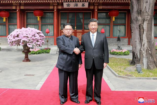 <p>North Korean leader Kim Jong Un shakes hands with Chinese President Xi Jinping in Beijing, as he paid an unofficial visit to China, in this undated photo released by North Korea's Korean Central News Agency (KCNA) in Pyongyang March 28,2018. (Photo: KCNA/via Reuters) </p>
