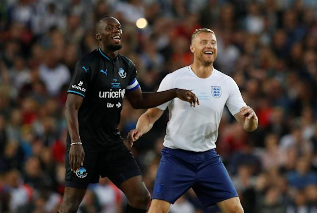 Soccer Football - Soccer Aid 2018 - England v Soccer Aid World XI - Old Trafford, Manchester, Britain - June 10, 2018 World XI's Usain Bolt with England's Freddie Flintoff REUTERS/Phil Noble