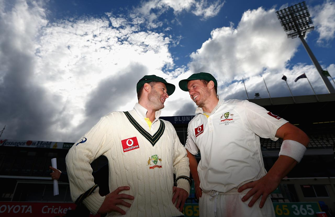 HOBART, AUSTRALIA - DECEMBER 18: Michael Clarke and Peter Siddle of Australia talk after Australia defeated Sri Lanka on day five of the First Test match between Australia and Sri Lanka at Blundstone Arena on December 18, 2012 in Hobart, Australia.  (Photo by Robert Cianflone/Getty Images)