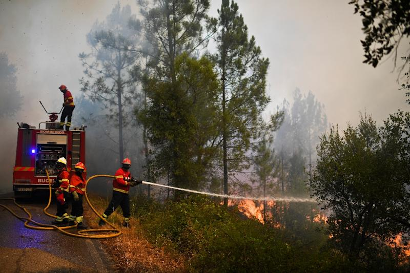 Firefighters battling blazes in central Portugal are worried about the hotter weather forecast, which increases the risk that old fire sites will rekindle or new fires will break out in the coming days (AFP Photo/PATRICIA DE MELO MOREIRA)