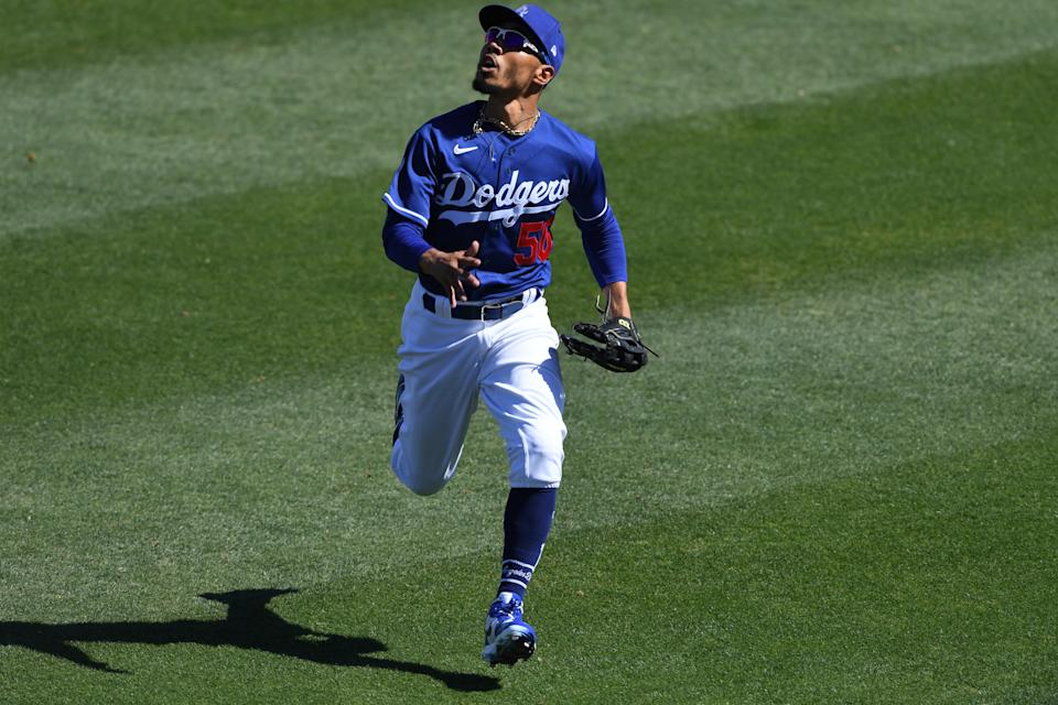 GLENDALE, ARIZONA - MARCH 08: Mookie Betts #50 of the Los Angeles Dodgers runs to make a catch against the Chicago White Sox during a spring training game at Camelback Ranch on March 08, 2021 in Glendale, Arizona. (Photo by Norm Hall/Getty Images)