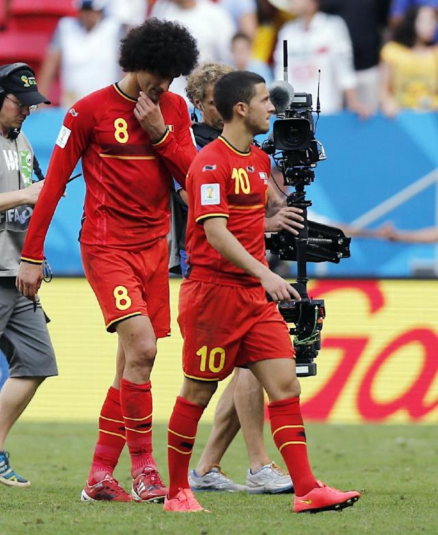 Belgium's Eden Hazard (10) and Marouane Fellaini are filmed as they walk off the pitch following Argentina's 1-0 victory over Belgium after the World Cup quarterfinal soccer match at the Estadio Nacional in Brasilia, Brazil, Saturday, July 5, 2014. (AP Photo/Victor R. Caivano)
