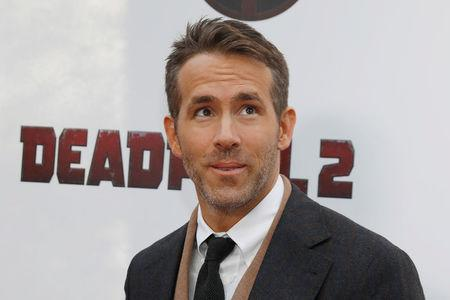 "FILE PHOTO: Actor Ryan Reynolds poses on the red carpet during the premiere of ""Deadpool 2"" in Manhattan New York"