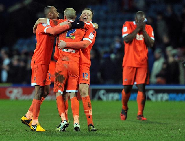 Millwall players celebrate their 1-0 win over Blackburn Rovers' Jordan Rhodes at the end of their English FA Cup quarter-final football match replay in Blackburn, northwest England on March 13, 2013 (AFP Photo/Paul Ellis)
