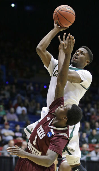 Cal Poly guard Dave Nwaba, top, shoots over Texas Southern guard D.D. Scarver (1) in the first half of a first-round game of the NCAA college basketball tournament on Wednesday, March 19, 2014, in Dayton, Ohio. (AP Photo/Al Behrman)