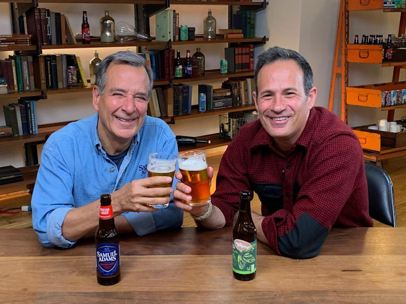 Jim Koch and Sam Calagione holding glasses of beer