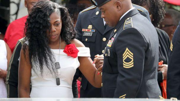 PHOTO: Myeshia Johnson, the wife of Army Sgt. La David Johnson at his casket after the burial at Hollywood Memorial Gardens, Oct. 21, 2017. (Mike Stocker/South Florida Sun-Sentinel/Polaris)