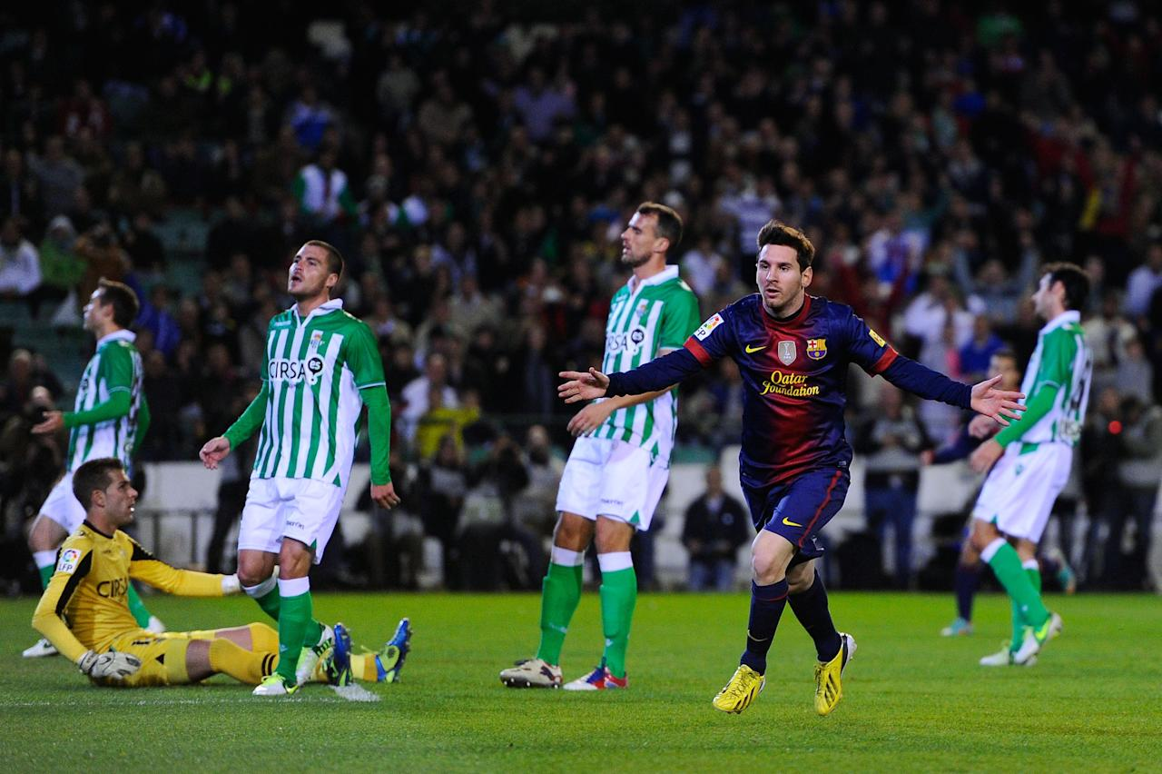 SEVILLE, SPAIN - DECEMBER 09:  Lionel Messi of FC Barcelona (R) celebrates after scoring the opening goal during the La Liga match between Real Betis Balompie and FC Barcelona at Estadio Benito Villamarin on December 9, 2012 in Seville, Spain.  (Photo by David Ramos/Getty Images)