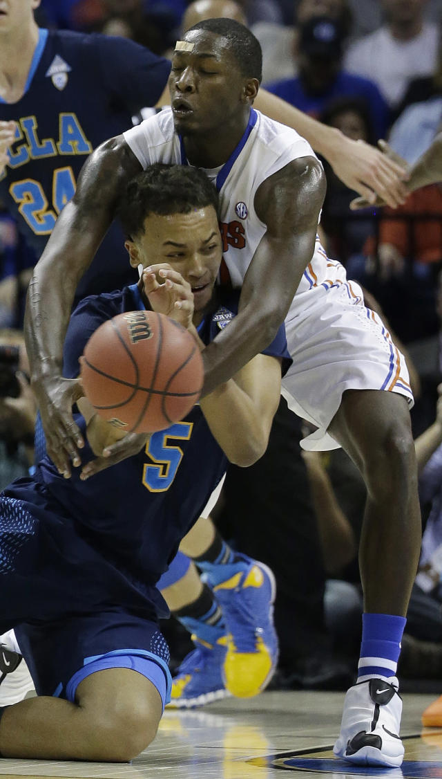 UCLA guard/forward Kyle Anderson (5) works against Florida forward Dorian Finney-Smith (10) during the first half in a regional semifinal game at the NCAA college basketball tournament, Thursday, March 27, 2014, in Memphis, Tenn. (AP Photo/Mark Humphrey)