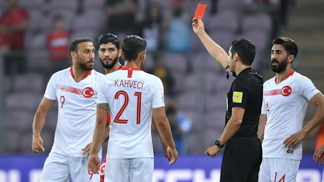 The forward was shown a straight red card after leaving the pitch to confront fans who were reportedly in an altercation with his family