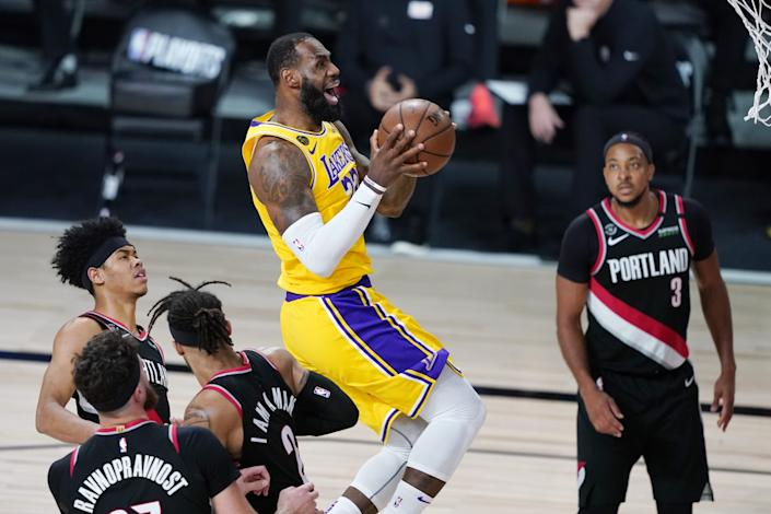 """The Lakers' LeBron James scores Saturday night. If he was fatigued from the central role he played in the players agreeing to resume the season, he didn't show it. <span class=""""copyright"""">(Ashley Landis / Associated Press)</span>"""