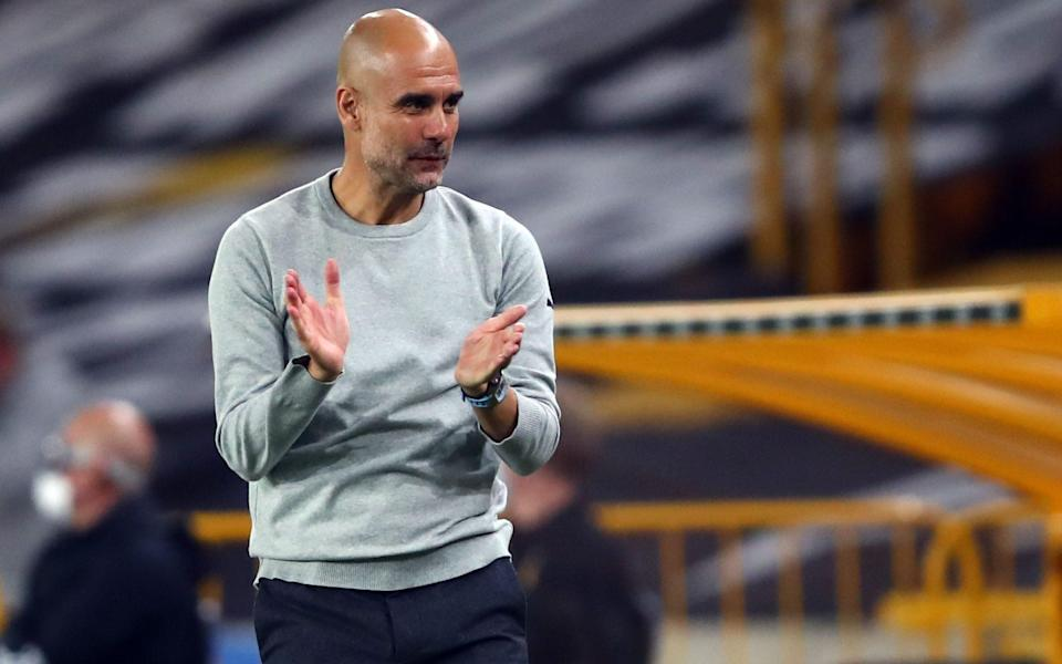 Pep Guardiola applauds his players - SHUTTERSTOCK