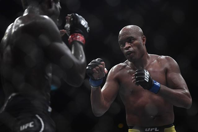 Brazilian fighter Anderson Silva (R) competes against US fighter Jared Cannonier (L) during their men's middleweight bout at the Ultimate Fighting Championship 237 event (UFC 237) at Jeunesse Arena in Rio de Janeiro on May 11, 2019. (Photo by Mauro Pimentel / AFP) (Photo credit should read MAURO PIMENTEL/AFP via Getty Images)