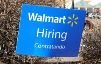FILE PHOTO: A sign seeking workers is seen at a Walmart store in Westminster