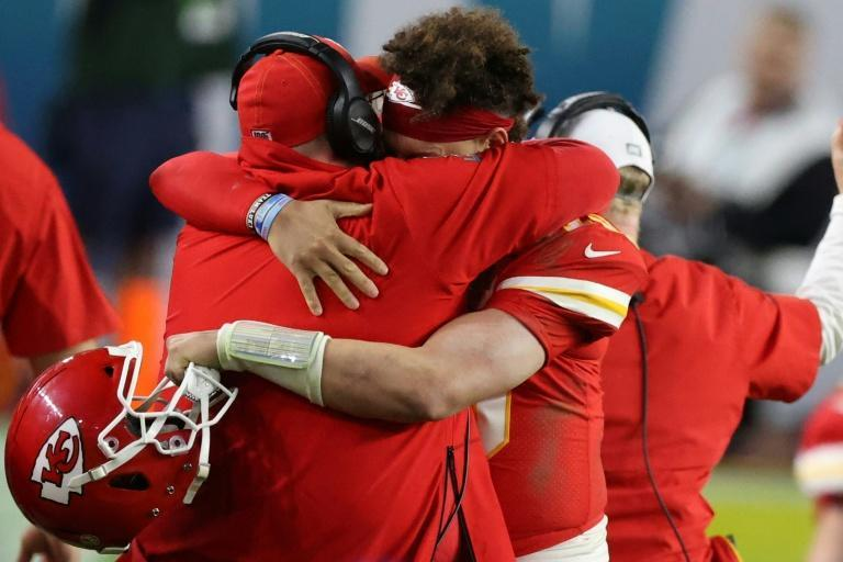 Chiefs coach Andy Reid hugs quarterback Patrick Mahomes after last season's Super Bowl victory in Miami