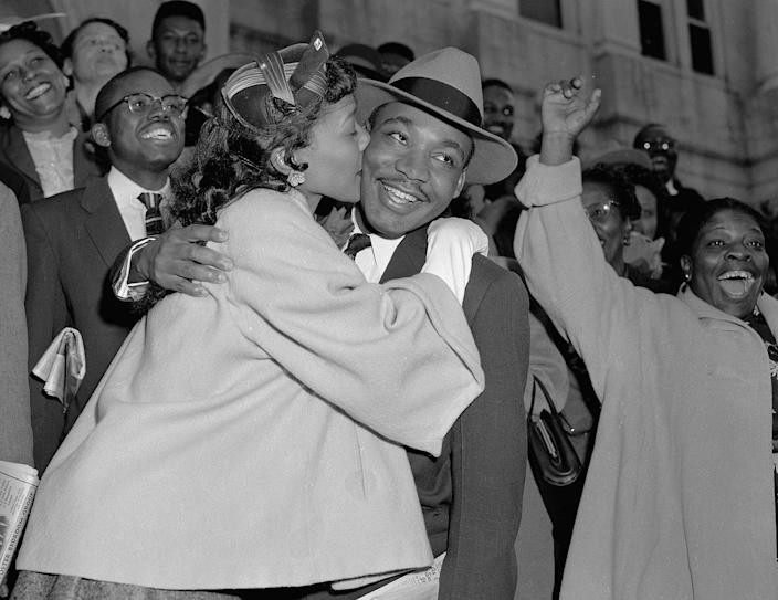 <p>The Rev. Martin Luther King Jr. is welcomed with a kiss by his wife Coretta after leaving court in Montgomery, Ala., March 22, 1956. King was found guilty of conspiracy to boycott city buses in a campaign to desegregate the bus system, but a judge suspended his $500 fine pending appeal. (AP Photo/Gene Herrick) </p>
