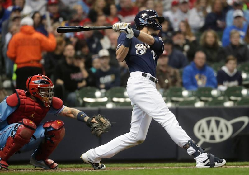Christian Yelich is the first player to open his post-MVP year campaign with home runs in three consecutive games. (AP Photo)