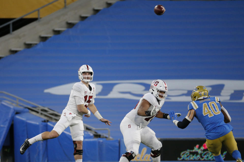 Stanford quarterback Davis Mills (15) passes the ball during the first half of an NCAA college football game between UCLA and Stanford Saturday, Dec. 19, 2020, in Pasadena, Calif. (AP Photo/Ringo H.W. Chiu)