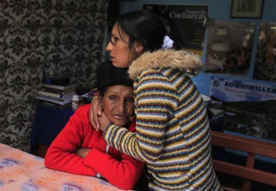 Marathon runner Gladys Tejeda, the first Peruvian athlete who qualified for the 2012 London Olympic Games, embraces her mother Marcelina Pucuhuaranga at her home in the Andean province of Junin, May 13, 2012.