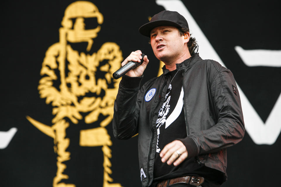 READING, ENGLAND - AUGUST 24:  Tom DeLonge of Angels And Airwaves performs on the main stage during Day 1 of Reading Festival at Richfield Avenue on August 24, 2012 in Reading, United Kingdom.  (Photo by Marc Broussely/Redferns via Getty Images)