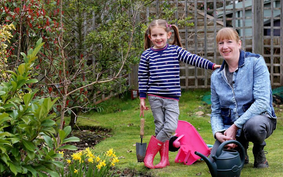 Catherine Shirley with daughter Lily in their garden in Croydon, south London - Clara Molden for The Telegraph