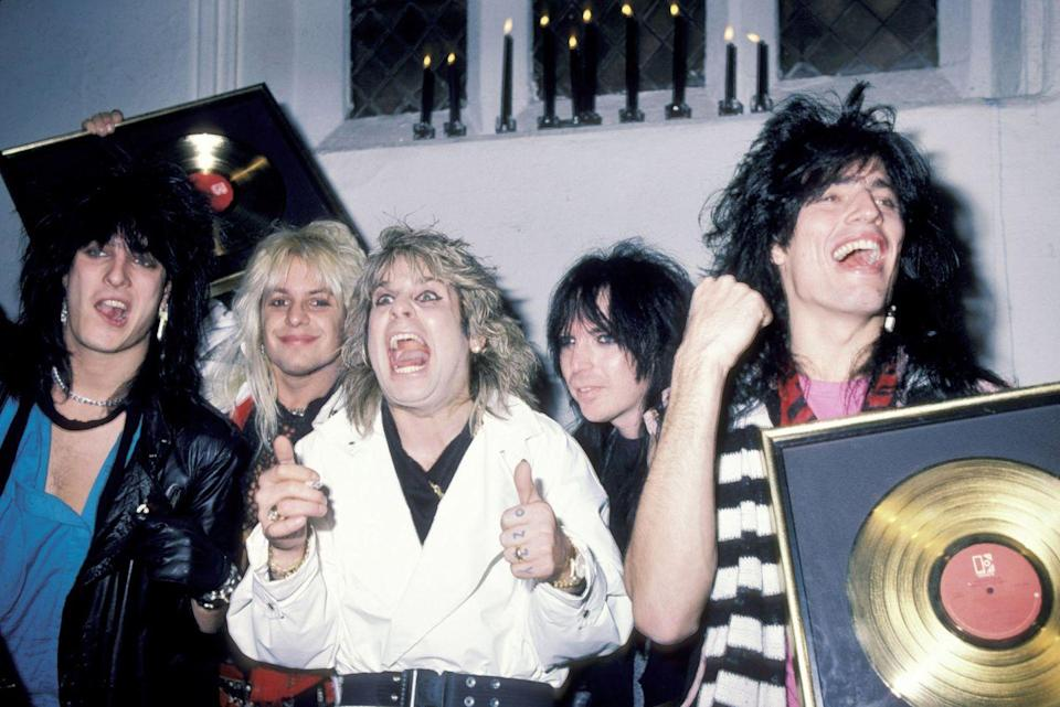 <p>Mötley Crüe and Osbourne met during a sound check in Maine and immediately hit it off—so much so that Osbourne moved into the Crüe's tour bus after meeting. Here they are at the Ozzy Osbourne Concert After-Party at Peter Gatien's Limelight Entertainment Complex in New York City in 1984.</p>