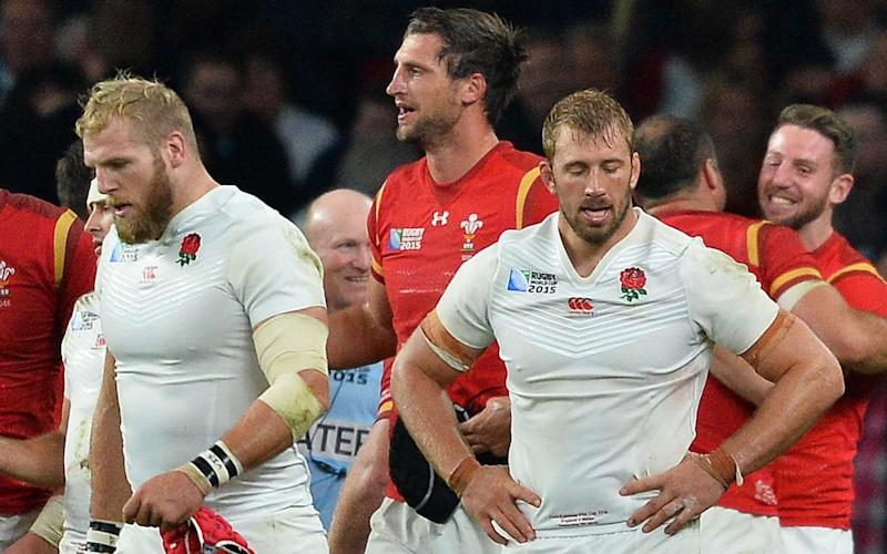 England's flanker Chris Robshaw (R) and England's back row James Haskell react following thier Pool A match of the 2015 Rugby World Cup between England and Wales at Twickenham - James Haskell lifts lid on England's disastrous 2015 World Cup and lambasts leadership skills of Stuart Lancaster - GETTY IMAGES