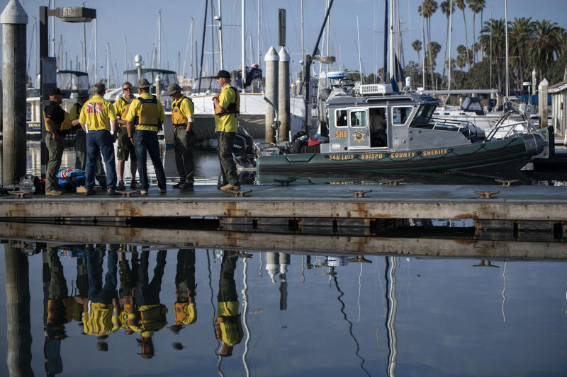 Divers with the San Luis Obispo County Sheriff's Dive Team prepare to search for a second day for missing people following a dive boat fire off Southern California's coast that killed dozens sleeping below deck, in Santa Barbara, Calif., Sept. 3, 2019. (Photo: Christian Monterrosa/AP)