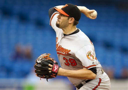 Baltimore Orioles starting pitcher Jason Hammel delivers to the Toronto Blue Jays during the first inning of a baseball game, Wednesday, May 30, 2012, in Toronto. (AP Photo/The Canadian Press, Frank Gunn)