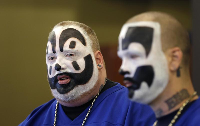 Joseph Bruce aka Violent J, left, and Joseph Utsler aka Shaggy 2 Dope, members of the Insane Clown Posse address the media in Detroit, Wednesday, Jan. 8, 2014. The rap metal group sued the U.S. Justice Department on Wednesday over a 2011 FBI report that describes the duo's devoted fans, the Juggalos, as a dangerous gang, saying the designation has tarnished their fans' reputations and hurt business. The American Civil Liberties Union filed the lawsuit in Detroit federal court on behalf of the group's two members. (AP Photo/Carlos Osorio)