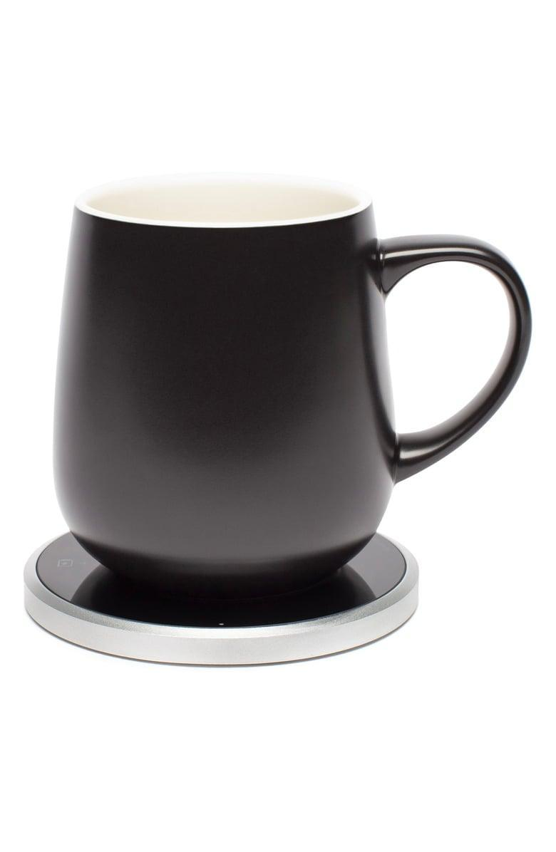<p>This <span>Ohom Kopi Mug &amp; Warmer Set</span> ($75) will make sure your coffee stays warm all day long.</p>