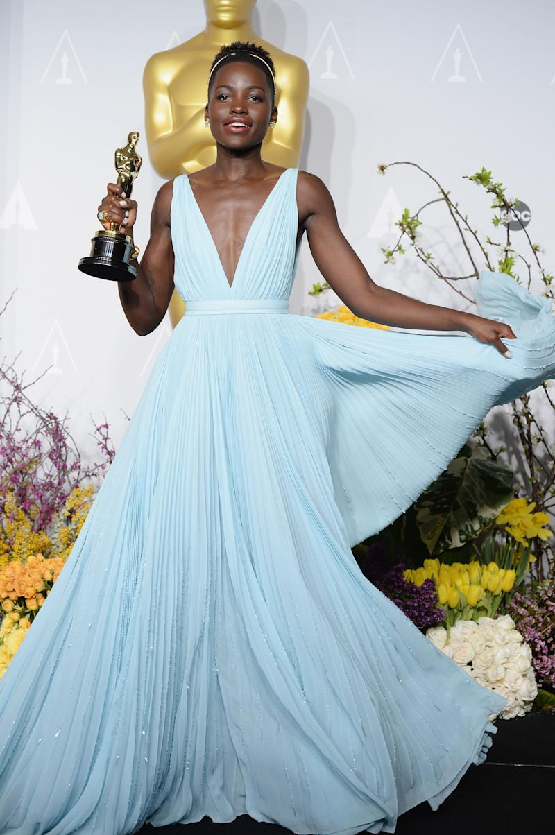 If you're going to win an Oscar, you may as well look like a living Disney princess. Lupita Nyong'o fluttered around in this Prada gown with a matching head band.