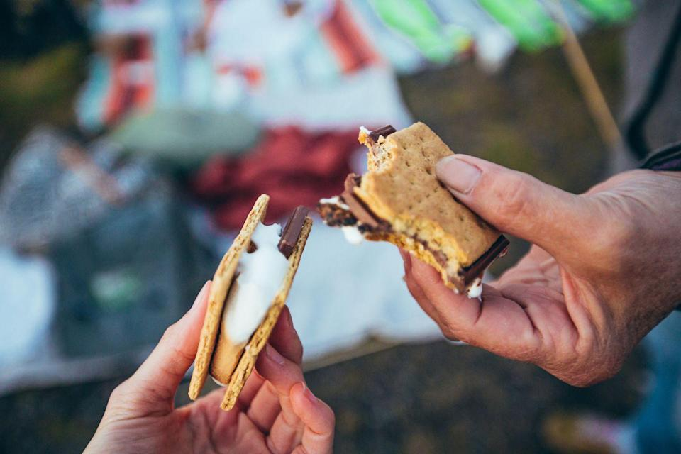 """<p>Speaking of heating things up, if you have a safe space to do it, start a fire and make s'mores. It's a lighthearted activity that'll take you back to your childhood days, and what could be cozier than that?</p><p><strong>Related: </strong><a href=""""https://www.countryliving.com/food-drinks/g2006/smores-dessert-recipes/"""" rel=""""nofollow noopener"""" target=""""_blank"""" data-ylk=""""slk:S'mores Dessert Recipes for the Sweetest Summer Ever"""" class=""""link rapid-noclick-resp"""">S'mores Dessert Recipes for the Sweetest Summer Ever</a></p><p><a class=""""link rapid-noclick-resp"""" href=""""https://www.amazon.com/Kraft-Jet-Puffed-Marshmallows-Pack-2/dp/B0868ZF8RT/ref=sr_1_3?tag=syn-yahoo-20&ascsubtag=%5Bartid%7C10050.g.35949770%5Bsrc%7Cyahoo-us"""" rel=""""nofollow noopener"""" target=""""_blank"""" data-ylk=""""slk:SHOP MARSHMALLOWS"""">SHOP MARSHMALLOWS</a></p>"""